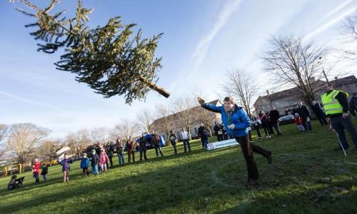 Play Hard at the Christmas Tree Throwing Championship