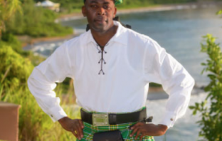 black man wearing Irish costume