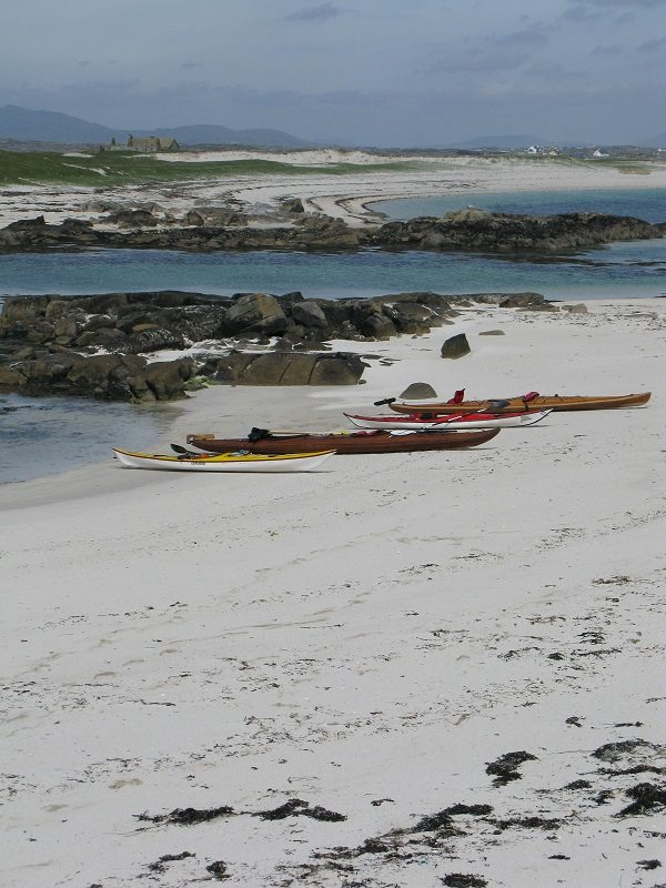 4 kayaks on a beach