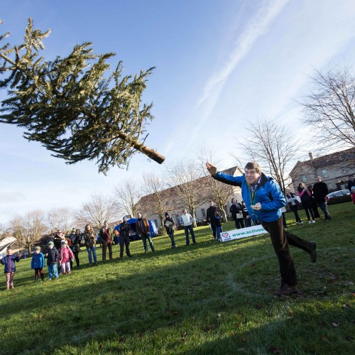 Play Hard at the Christmas Tree Throwing Championship