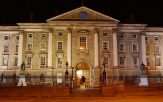 front of trinity college dublin at night