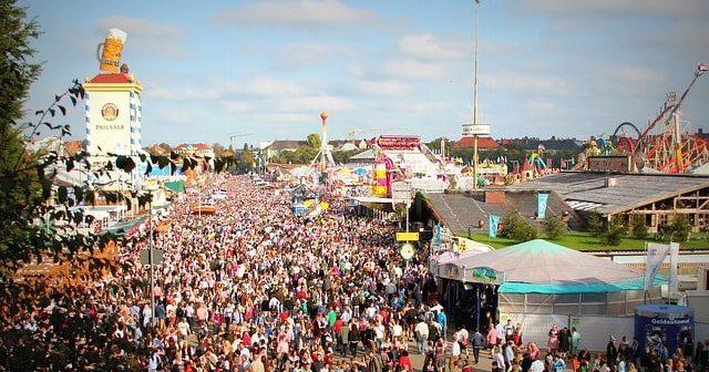 Crowds and fairground at Oktoberfest Munich