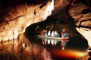 people on a boat in a cave