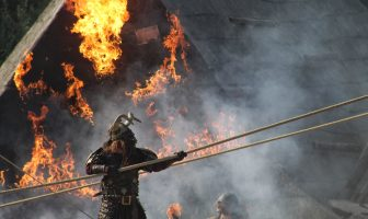viking in front of a burning building