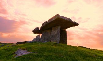 dolmen on a hill against the sunset