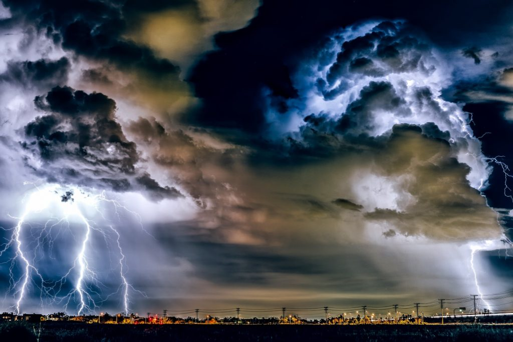 lightning and dark clouds over a city