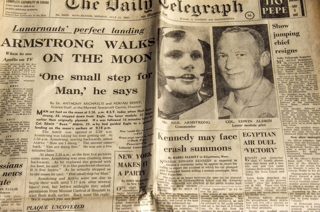 newspaper front page from July 1969 reporting on moon landing