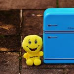 small blue fridge with cuddly toy