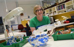 Susan Arthure pictured with some of the ceramic artefacts found at the Baker's Flat clachan