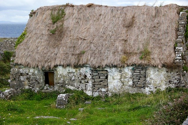 A run-down traditional Irish cottage with tatched roof