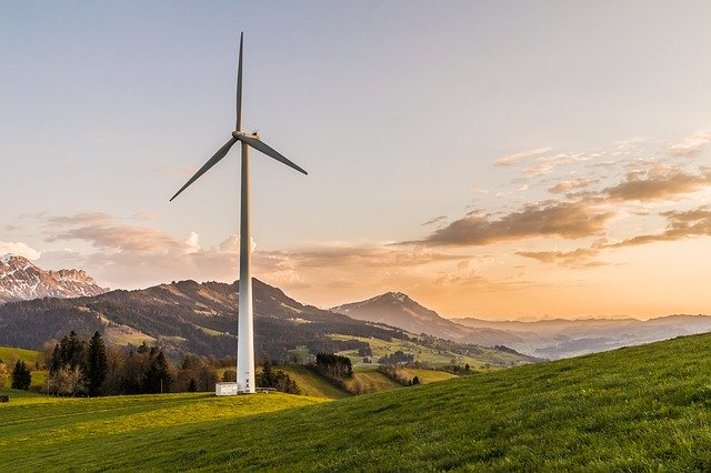 wind turbine with scenic mountain view