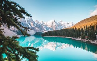 Canada landscape, lake surrounded by snow-capped mountains